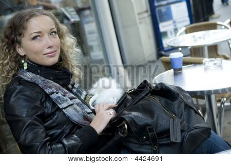 Attractive Girl Sitting In Open-air Cafe