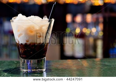 White russian cocktail on the background of the bar