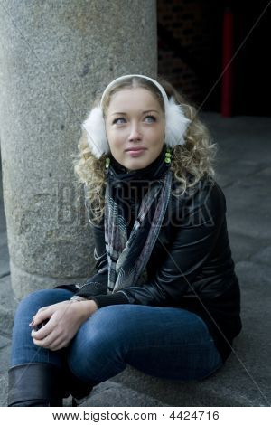 Attractive Girl Sitting On Pavement