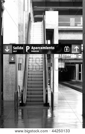 Railway Station With Signposting And Escalators