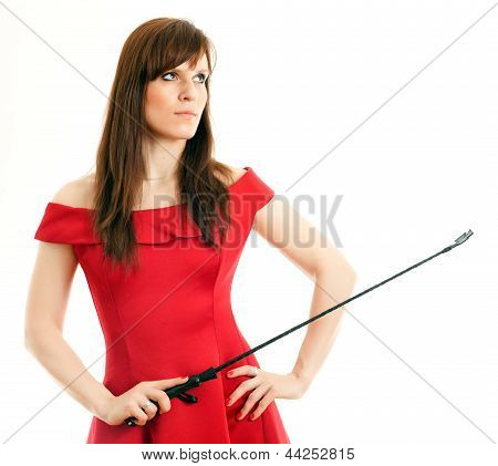 woman in a dress holding a riding crop