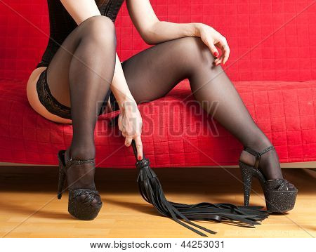 woman in stockings and whip