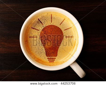 idea. cup of fresh espresso with bulb sign, view from above