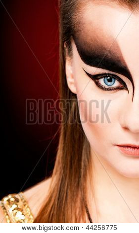 Close-up shot of beautiful young woman face with stylish black make-up