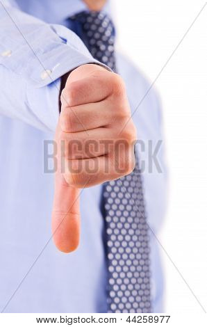 Business man showing thumbs down sign.
