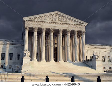 The United States Supreme Court with storm sky.