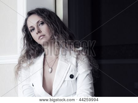Sad beautiful woman at apartment