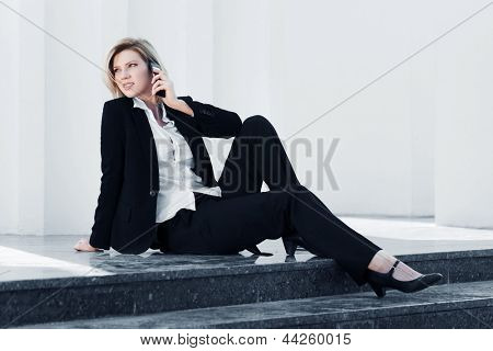 Young business woman calling on the mobile phone