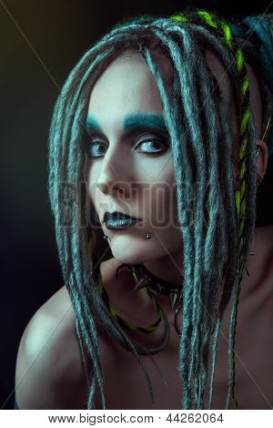 Young woman with dreadlocks