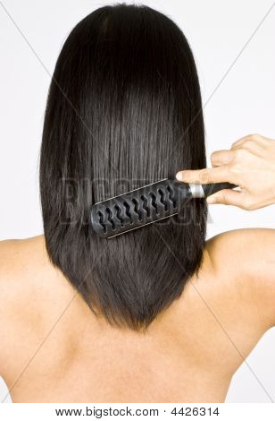 Woman Brushing Her Long Black Hair