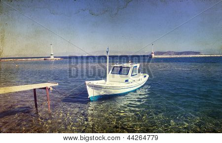 Vintage photo of a lonely boat