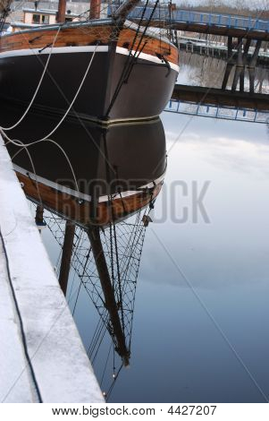 Ships Bow Reflected In Water.