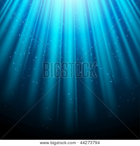 Blue glowing light background with luminous rays.