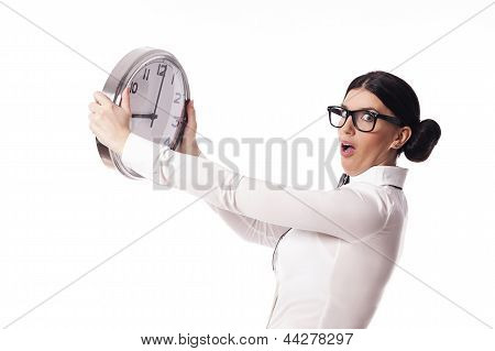Shocked woman holding an office clock