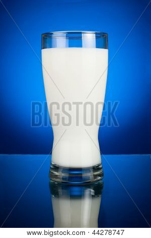 Glass Of Fresh Milk On A Dark Blue Background