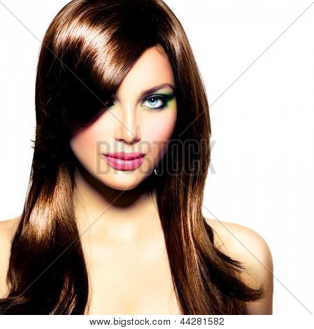 Beautiful Brunette Girl with Healthy Long Brown Hair and Blue Eyes. Beauty Model Woman with Professional Makeup. Hairstyle. Stylish Haircut. Fringe. Glossy Smooth Fashion Hair. Extensions