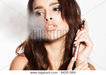 woman smoking e-cigarette with the smoke on the side