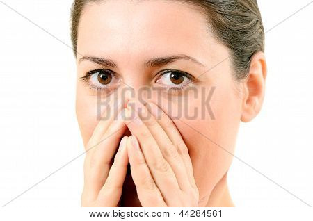 Bright Closeup Picture Of Woman With Hands Over Mouth