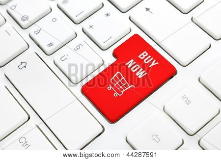 Shop Buy Now Business Concept. Red Shopping Cart Button Or Key On White Keyboard