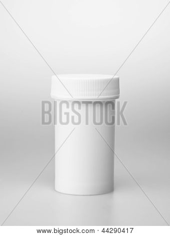 Small white medecine bottle