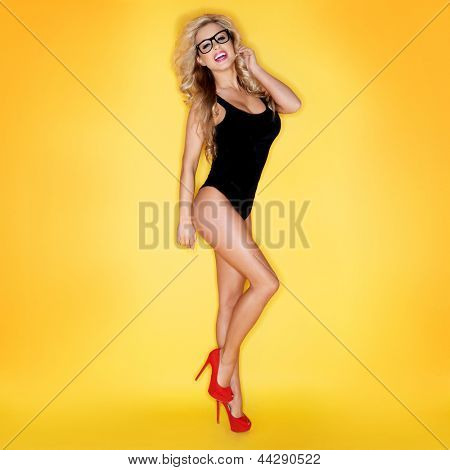 Sexy Woman In Swimwear Wearing Eyeglasses Isolated On Yellow Background