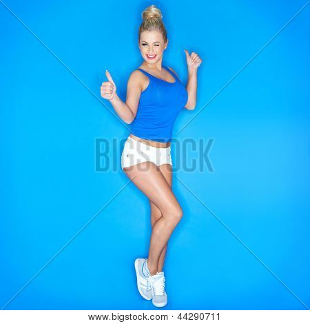 Young Woman Squinting And  Showing Thumb Up Sign On Blue Background
