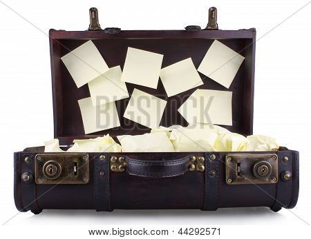 Open Old Suitcase With Yellow Notepad