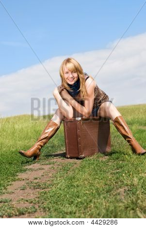 Girl Sitting On The Suitcase
