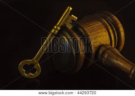 Key and Gavel - decision making success in government concept - purposeful high key image.