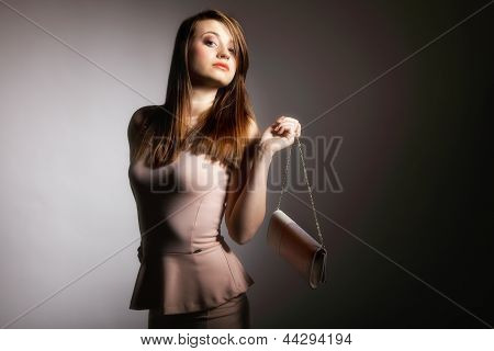 Beautiful Young Woman With Handbag.