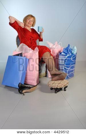 Older Lady Relaxing After Shopping