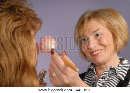 Attractive Older Lady Make Up Artist Applies Blusher