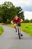 Girl biking on cycle lane