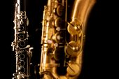 foto of sax  - Classic music Sax tenor saxophone and clarinet in black background - JPG