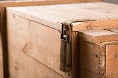 Closeup of metal latch on old wooden chest