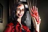 foto of gruesome  - Demon like female businessperson waving hello inside a corporate office with sawn off hand in a depiction of untrustworthy business partnerships - JPG