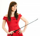 picture of riding-crop  - beautiful woman in a red dress holding a riding crop on white background - JPG