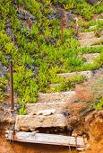 stock photo of nea  - Old ruined concrete stairs at the beach in Nea Moudania - JPG