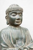 foto of siddhartha  - Buddha stone figurine isolated against white background - JPG