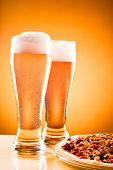 stock photo of take out pizza  - Two glass of beer and pizza over yellow background - JPG