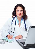 Medical doctor woman with laptop computer. Health care.