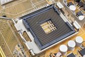 stock photo of processor socket  - Processor socket on motherboard extreme close up - JPG