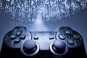 stock photo of controller  - Game controller and blue light - JPG