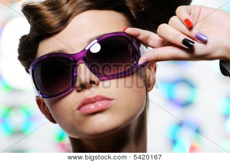 Stylish Sunglasses On The Beautiful Female Face