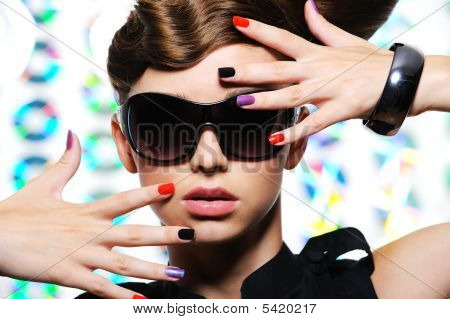 Woman With Fashion Multicolored Manicure And Female Stylish Sunglasses
