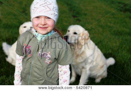 Little Girl With Dogs Behind