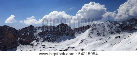 Panorama Of Snow Mountains In Sunny Day