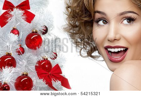 beauty portrait of attractive smiling young caucasian woman christmas tree face closeup skin teeth studio shot