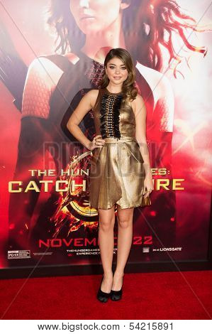 LOS ANGELES, CA - NOVEMBER 18: Actress Sarah Hyland arrives at the premiere of The Hunger Games: Catching Fire at the Nokia Theater in Los Angeles, CA on November 18, 2013