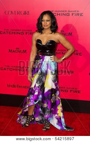 LOS ANGELES, CA - NOVEMBER 18: Actress Garcelle Beauvais arrives at the premiere of The Hunger Games: Catching Fire at the Nokia Theater in Los Angeles, CA on November 18, 2013